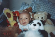 Justin infant with stuffed animals